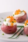 decorate garnish delicious red potatoes with gourmet salmon caviar